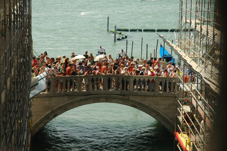 crowded venice bridge, full of tourists