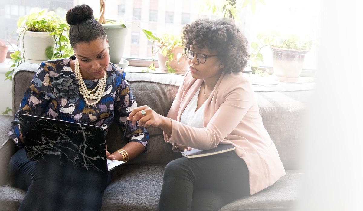 Upside Productions - Business Women on laptop