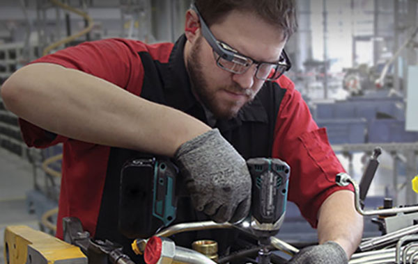Automotive worker using augmented reality for field service