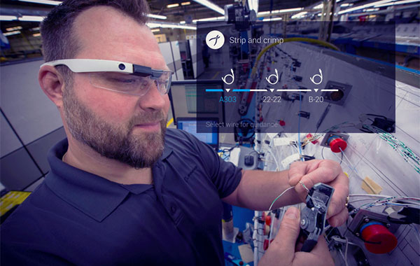 Aerospace worker using augmented reality solution by Upskill to find the proper wire placement.