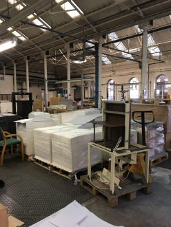 Pallets of paper line the finishing floor.