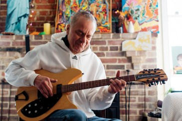 "Russell Stone was born in Connecticut and moved to Annapolis in 1968. Started playing when he was 12 years old on his mother's old ""crummy"" guitar as he calls it."