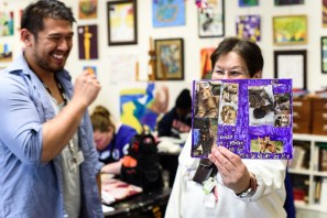 Art instructor at Arundel Lodge, Mark Rollamas jokes around with artist Diane Armstrong as she proudly shows off her collage work. The Open Eye Gallery and art program at Arundel Lodge in Edgewater provides a creative space for adults impacted by mental health and substance use disorders. Many of their works are shown around the area at various galleries and museums and sold to the community to pay the artists and cover supply expenses. Photos by Alison Harbaugh. Sugar Farm Productions