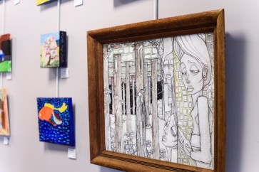 """Hallways and rooms throughout the Arundel Lodge are decorated with artworks by the Open Eye Gallery participants. Large mixed media piece """"Night Thoughts"""" by Christian McCarroll. Photos by Alison Harbaugh. Sugar Farm Productions"""