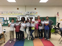 Charting Careers kids in Create the Story of You after school program show off their awards at graduation.
