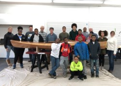 After 8 weeks of sweat equity, Box of Rain kids and volunteers show off the finished product—a Wood Duck kayak.