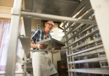 Chris Simmons, owner and baker at Bakers and Co. in Eastport. Prepares tray of pastries early in the morning at the bakery. Photo by Alison Harbaugh