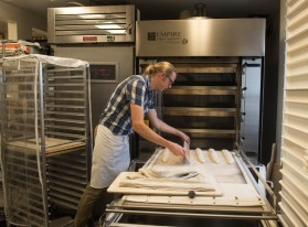 Chris Simmons, owner and baker, prepares fresh baguettes early in the morning at Bakers and Co. in Eastport. Photo by Alison Harbaugh