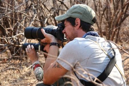 Mike and Nancy photographing very rare wild black rhinos in Zimbabwe.