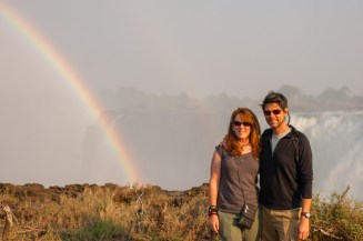 Mike and Nancy in front of Victoria Falls on a trip to Zimbabwe.