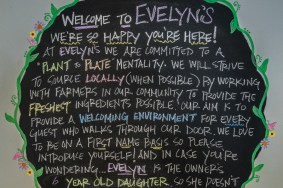 A welcome sign greets customers in the dining room at Evelyn's.