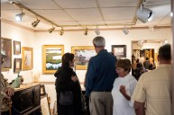 10/5/18: Art lovers and artists gatherer at McBride Gallery to view the 10 painted violins painted by local artists to raise funds for the Annapolis Symphony Academy. Photo by Alison Harbaugh