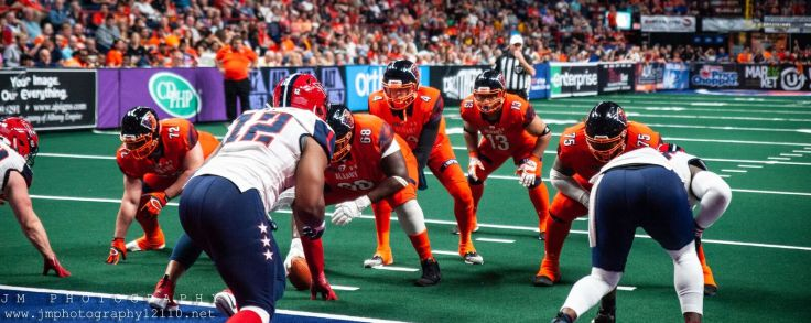 The Albany Empire (orange) and the Washington Valor (white) line up for a play on Saturday. Photo: Jon Monaghan/UC Sports