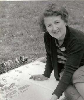 Zetta Schneider prepares Guest Book for visitors to sign.