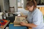 Zetta and Benny Schneiders granddaughter Karren looking over Fairyland scrapbooks