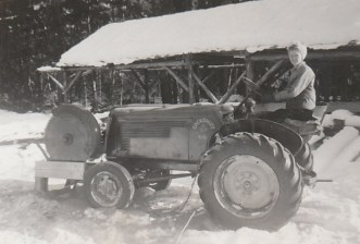 Margaret on Tractor at Joe Ramsden's Mill Jan 1948 during construction of the Question Mark Store photo credit - Patsy Ormond