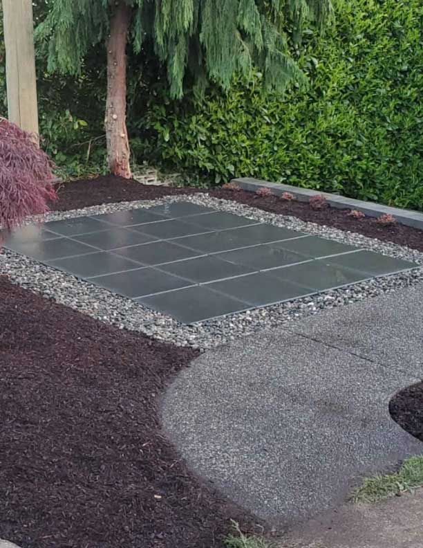 paver stones with gravel outline concrete walkway