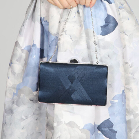 Perfect Bridal navy rectangular clutch bag. Is crafted in silky satin and decorated with woven crisscross satin bands