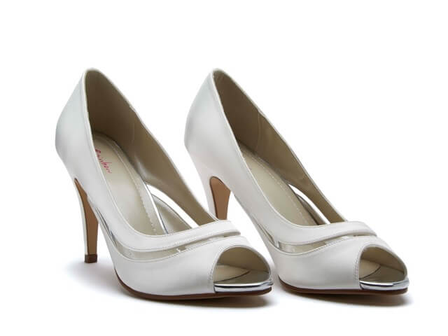 Rainbow Club Eloisa ivory bridal shoes. They have a peep toe, a high stiletto heel and chic vinyl detail which curves around the foot