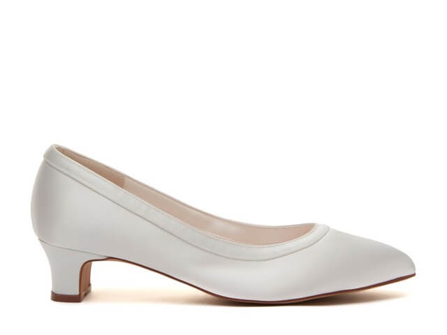 Rainbow Club Giselle ivory satin bridal shoes. They have an almond toe, chic low heel and are finished with a pretty satin overlay trim