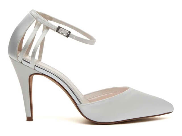 Rainbow Club Kennedy ivory satin bridal shoe. They have a pointed toe, high stiletto heel and are finished with cage detailing to the back of the heel, fastening with a delicate ankle strap