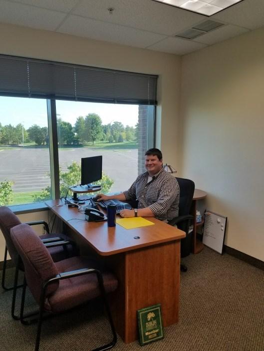 John Paull sitting at Uptrend Desk