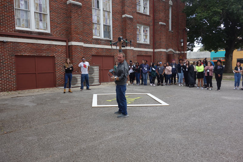 Man giving Drone Workshop Outdoors