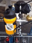 Coffee carrying contraption:. Note: sticker.