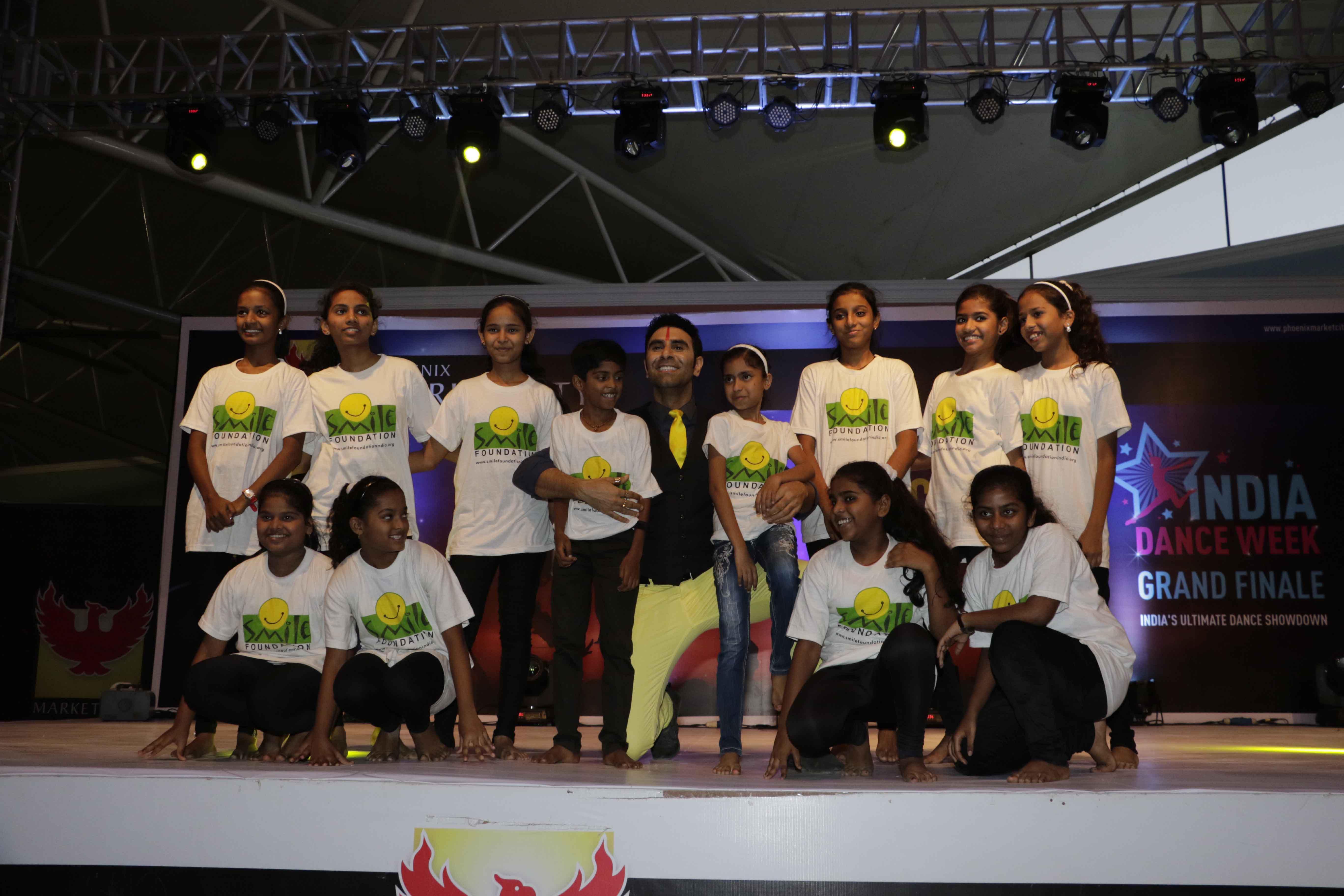 Sandip Soparrkar performing with Smile Foundation Children