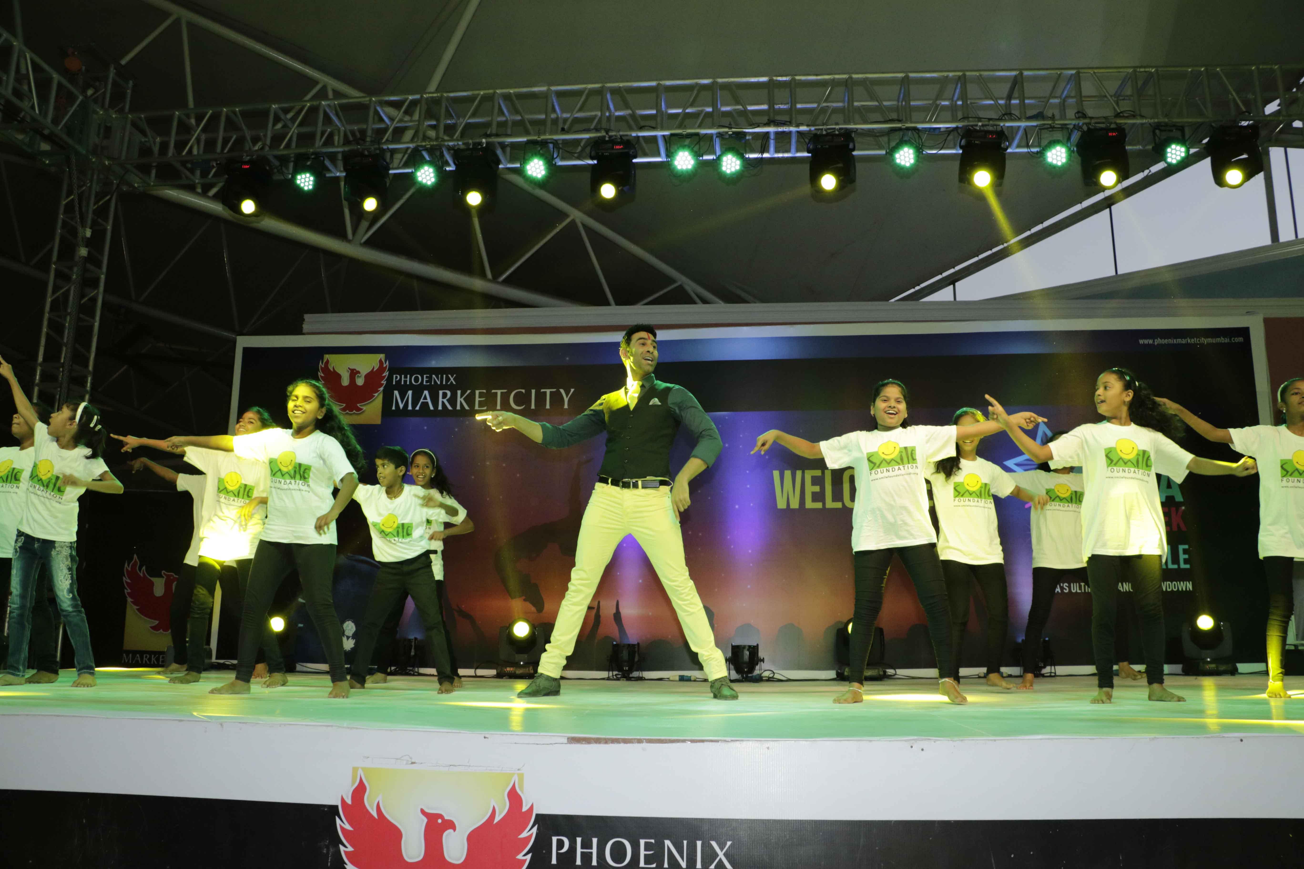 Sandip Soparrkar performing with Smile Foundation Children3