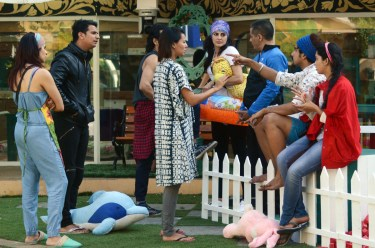 Mandana Karimi with other contestants in the garden area of Bigg Boss. (Image Courtesy - Colors.)