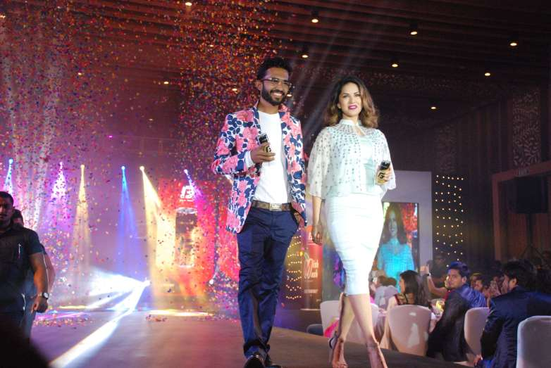 Bollywood actress Sunny Leone seen with Rahul Vinayika, MD of RZ International Pvt Ltd during the launch of Gold Fogg, an energy drink in Bengaluru on Sunday 7