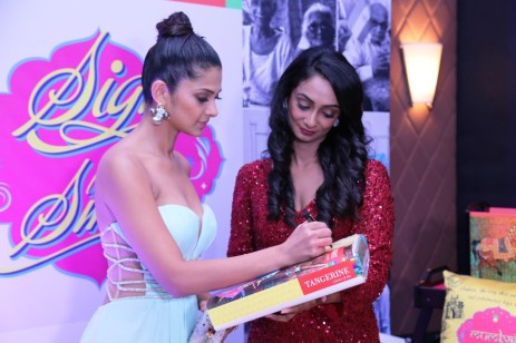 Jennifer Winget signs for a CSR initative by Tangerine to donate bedsheets to oldage home