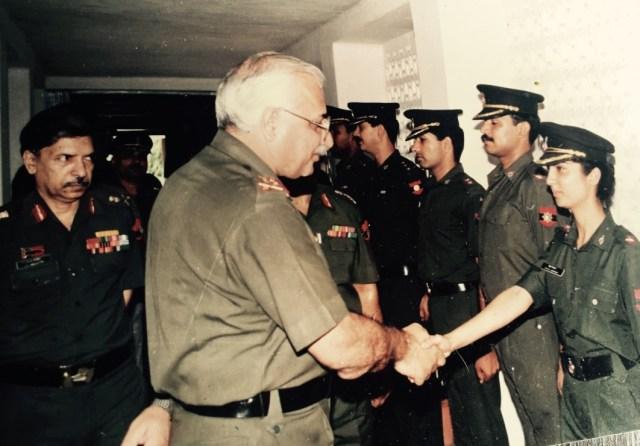 Lt Gen YN Sharma, PVSM,AVSM,VSM, General Officer Commanding in Chief , Central Command shakes hands with 2 Lt Priya Jhingan.