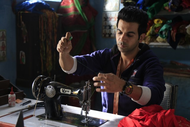 Image result for images of rajkumar rao doing tailoring in his new movie stree