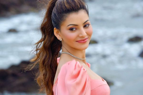 Urvashi Rautela gives us major summer style goals, looks dreamy in a salmon peach corset dress