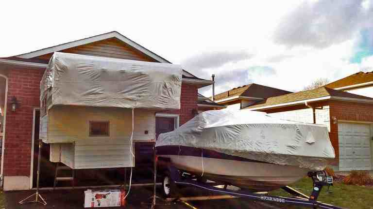 Recreational vehicle and boat shrink wrapped for winter storage