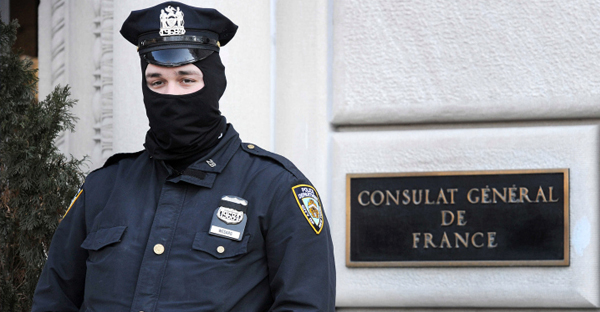 A New York City Police Officer is posted in front of the French Consulate in New York. (Anthony Behar)