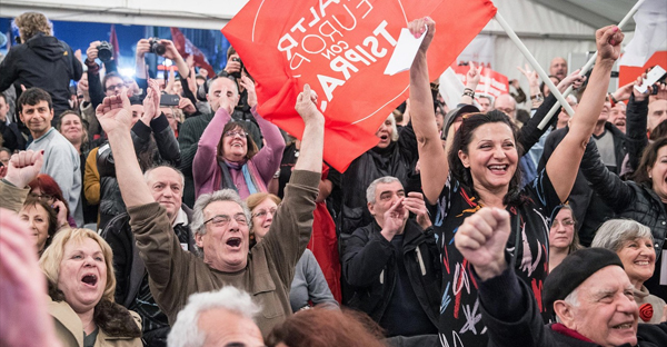 Supporters of Alexis Tsipras, leader of the radical left Syriza party, celebrated Sunday. (MICHAEL KAPPELER/DPA/ZUMA PRESS)