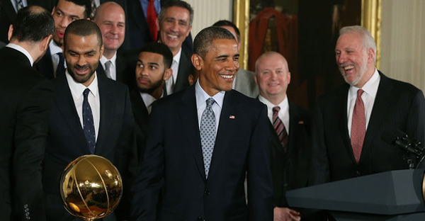 U.S. President Barack Obama smiles during an event to honor the 2014 NBA Champion San Antonio Spurs in the East Room at the White House, January 12, 2015 in Washington, DC. (Mark Wilson/Getty Images North America)