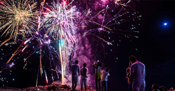 People watch New Year's fireworks at Barra beach in Salvador, Brazil. (Yasuyoshi Chiba / AFP - Getty Images)