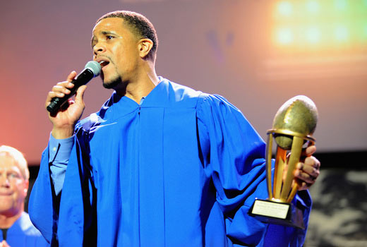 Former NFL player Olrick Johnson Jr. of the NFL Players Choir performs onstage during 16th Annual Super Bowl Gospel Celebration at ASU Gammage on January 30, 2015 in Tempe, Arizona. (Photo by Marcus Ingram/Getty Images for Super Bowl Gospel)