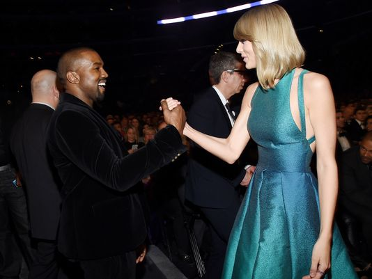Kanye and Taylor shake on it. (Photo: Larry Busacca, Getty Images for NARAS)