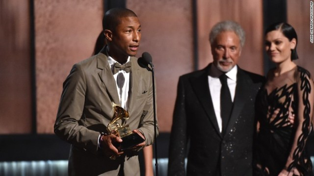 """Pharrell Williams collects his Grammy for best pop solo performance for """"Happy"""" on February 8."""