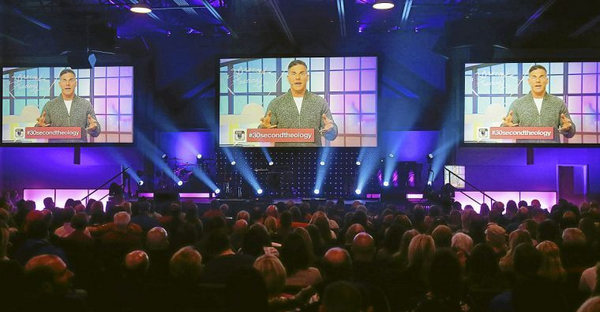 LifeChurch.TV senior pastor Craig Groeschel is projected on the big video screens in the sancturary during services Saturday night in Bixby. The church held a Super Bowl themed afternoon and service. (MICHAEL WYKE/Tulsa World)