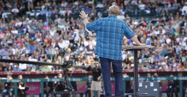 """During the Saddleback Church 35th Anniversary celebration at Angel Stadium, Pastor Rick Warren delivers a Sermon on the Mound, """"A Daring Faith,"""" the same message he preached during the first service hosted by Saddleback in 1980 - but this time in past tense, to demonstrate that the founding vision has become a reality. (A. Larry Ross/Facebook)"""