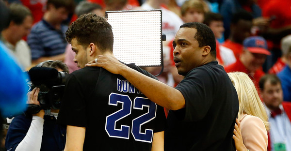 Head coach Ron Hunter of the Georgia State Panthers puts his arm around son and player R.J. Hunter #22 after the Panthers 57-56 win against the Baylor Bears during the second round of the 2015 NCAA Men's Basketball Tournament at Jacksonville Veterans Memorial Arena on March 19, 2015 in Jacksonville, Florida. (Kevin C. Cox/Getty Images North America)