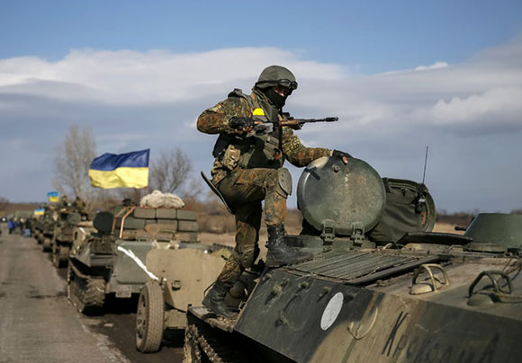 Convoy of Ukrainian armed forces, including armoured personnel carriers, military vehicles and cannons, prepare to move as they pull back from the Debaltseve region, in Blagodatne