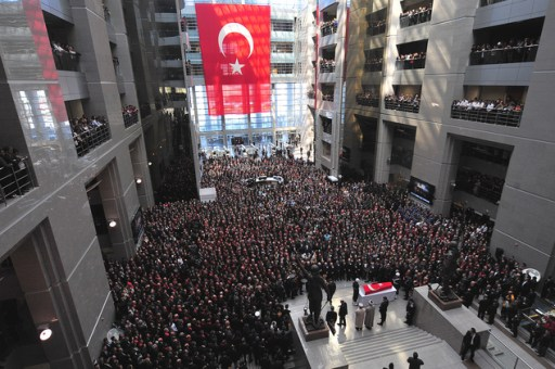 Some thousands of people attend the funeral ceremony for Turkish prosecutor Mehmet Selim Kiraz inside the main courthouse where he died on Tuesday in Istanbul, Turkey, Wednesday, April 1, 2015.