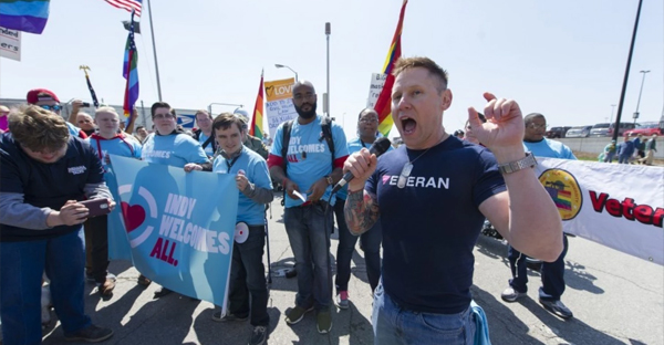 U.S. Army Maj. Steve Snyder-Hill, right, a gay rights activist, addresses opponents of Indiana Senate Bill 101, the Religious Freedom Restoration Act, during a demonstration in Indianapolis on Saturday, April 4, 2015. (AP Photo/Doug McSchooler)